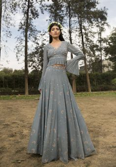 EVA- Ice Blue embellished printed lehenga skirt paired with hand embroidered blouse with ruching details. CARE: Dry Clean Only Indian Gowns Dresses, Indian Fashion Dresses, Dress Indian Style, Indian Designer Outfits, Fashion Clothes, Designer Dresses, Lehnga Dress, Lehenga Skirt, Jacket Lehenga