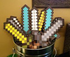 Handmade Minecraft swords using free printable sword cut out and glued to double foam board. Great party favors!