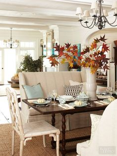 Happily, Mother Nature offers plenty of natural decorative items to situate throughout your seasonally decorated home. Simply fill a vase with leafy cut tree branches to bring the fall factor home.