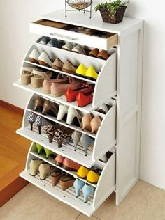 """""""Of course The Container Store would display the most beautifully organized closet on the planet. But with these shoe cubbies, yours can look just like it.""""   12 Inventive Ways to Organize Your Shoes via Brit + Co."""