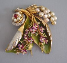DeROSA enameled fur clip with violets and leaves, 1940