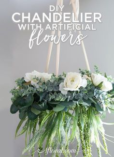 DIY Chandelier with Artificial Flowers! Learn how to make a flower chandelier with this simple video DIY. Using a wire wreath, artificial garland, sil Artificial Garland, Artificial Flower Arrangements, Artificial Flowers, Floral Garland, Flower Garlands, Diy Flowers, Flowers Garden, Flower Chandelier, Diy Chandelier