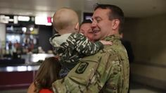 Soldier reunites with family, meets newborn son at Game 2 in Chicago (Video) | Puck Daddy - Yahoo! Sports