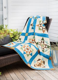 Angles create the illusion of light shining through a window in this sunrise-inspired quilt.