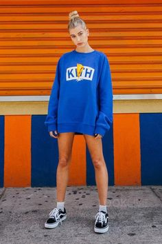 Hailey Baldwin wearing Vans Old Skool Sneakers, Kith NYC Graphic Hoodie