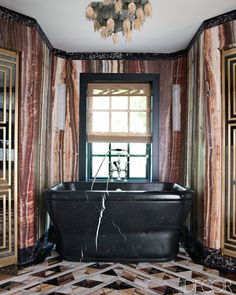 Master bathroom with onyx walls and onyx and marble mosaic floor in the Mercer Island home of Jeff and Laura Sanderson designed by Kelly Wearstler