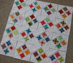https://flic.kr/p/7DhFBL | Cathedral Windows Quilt-4 x 4 | The quilt has now doubled in size.  It is 4 blocks of 4 by 4 blocks of 4.  They are still not sewn together yet.  I will be keeping the white diamonds empty but will sew open the windows.  I am going to keep going--another 4 blocks of 4 at a time. blogged here duringquiettime.blogspot.com/2010/02/cathedral-windows-qu...