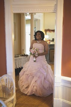 David's Bridal bride Candis is radiant in her blush gown.
