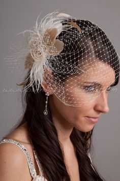 Bridal Veil Set, Ivory Wedge Birdcage Veil with Ivory and Champagne Feather Fascinator Amber. $89.95, via Etsy.