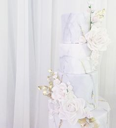 Wedding cake of my dreams! Love the marble effect/gold leaf. The flowers are perfect as well. Can we get this cake, but two tiers instead? And about the size of the two middle tiers in the pictured cake.
