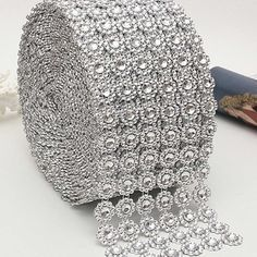 Wrap this rhinestone ribbon around candles, candle holder, vases, cake stands, table and chairs to provide a truly elegant look. The indentation gives the appearance of a Rows Diamond Rhinestone Crystal Mesh Ribbon Wrap 1 yBeautiful diaman Bling Wedding Centerpieces, Bling Wedding Cakes, Wedding Decorations, Party Centerpieces, Flower Decorations, Ribbon Wrap, Mesh Ribbon, Diy Ribbon, Giant Paper Flowers