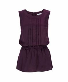 Pintuck Peplum Shell in Wild Plum . Sizes 0 to 18 . Buy it now - or find your Ricki's store - at www.rickis.com #rickis #summer2014
