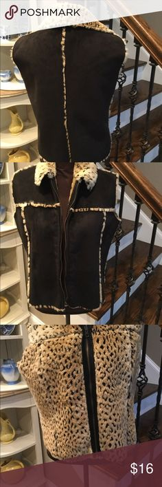 Ladies vest by Lisa International Size Large Very nice reversible vest,in faux suede and faux animal print trim,chocolate brown,with beige and brown faux fur trim, reverses to faux animal print fur,measures from arm opening to arm opening 21 inches, 22 inches long Size Large Jackets & Coats Vests