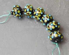 00573WBC Godotty lampwork beads in black with yellow by Roubogi, €3.40