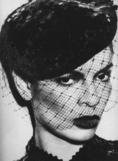 Sultry Bianca Jagger in a stunning birdcage veil.