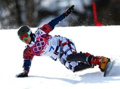 Vic Wild of Russia competes in the Snowboard Men's Parallel Giant Slalom Finals. Sochi 2014 Day 13 - Snowboard Men's Parallel Giant Slalom. © 2014 XXII Winter Olympic Games.