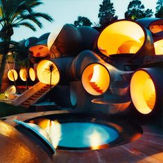 The Bubble House, near Cannes, was built in 1989 and designed by Antti Lovag for the French fashion designer Pierre Cardin. The futuristic design feels like a homage to the Barbapapa's housebuilding skills!  Possibly the most fun you could imagine in a house design.