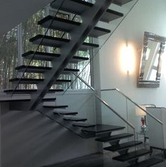 Stair. Steel plates central spine, glass and wood