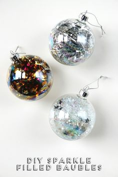 DIY Sparkle Filled Baubles - these ornaments are so obvious yet so cute. Put tinsel, glitter, and all into clear ornaments