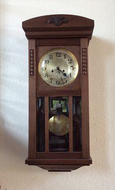 Orologio a pendolo stile liberty restaurato.