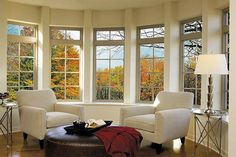Bay window - deciduous trees shade in summer and let light shine in winter when leaves fall.  Living Room Design Ideas from interiorfans.com