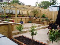 Deck at back of yard... interesting solution for slopes