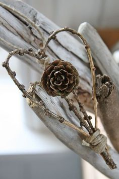 A simple yet ancient looking heart shaped want made out of twigs and a plant. It looks ethereal and what's best is you can find the materials used in your own backyard for free.