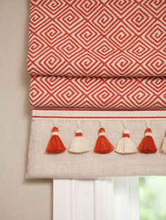 Give roman blinds a unique look with trims.