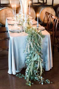 greenery table number - photo by Ashley Errington Photography http://ruffledblog.com/dusty-blue-winter-winery-wedding