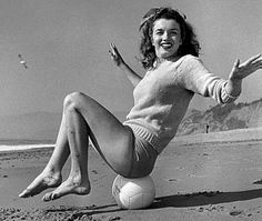 "1945 Andre' De Dienes photographer.  ""Beach Sitting Green Sweater"" 1945 beach sitting green pull mmad 032/1, Malibu California.  Image 23-62"