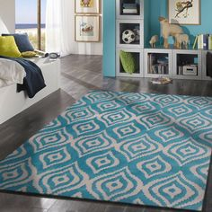 This sky blue rug is a very popular design,with it;s loud eye catching color,is to bring your room to life.Size(Width X Length):~5 X 7' ft.For purchasing information you can go to our link below. http://rugaddiction.com/collections/metric-collection/products/contemporary-sky-blue-bedroom-area-rug