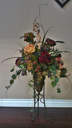 Tuscan Floral Arrangement in Metal Plant Stand. Church Flower Arrangements, Silk Floral Arrangements, Church Flowers, Artificial Flower Arrangements, Floral Centerpieces, Artificial Flowers, Silk Flower Bouquets, Silk Flowers, Dried Flowers