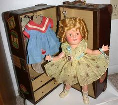 """16"""" compo Shirley Temple doll from 1935. This doll is in stunningly near mint condition. Shirley is wearing a Starburst dress from Curly Top and is in her original trunk with many extra dresses.  Z"""