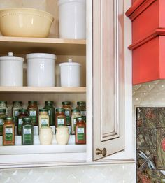 If your kitchen lacks counter space, stash spices in an overhead cabinet or pantry. A three-tier rack is simple to organize, allows for easy viewing, and enables plenty of storage.