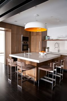 a square kitchen counter where four people can comfortably sit.