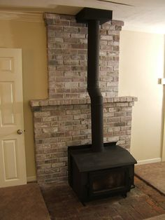 How To: White-Wash the Fireplace. Possible idea for the wood burning stove's brick hearth. How To: White-Wash the Fireplace. Possible idea for the wood burning stove's brick hearth. Wood Stove Surround, Wood Stove Hearth, Brick Hearth, Wood Burner, White Wash Fireplace, Brick Fireplace Wall, Stove Fireplace, Fireplace Surrounds, Fireplace Ideas