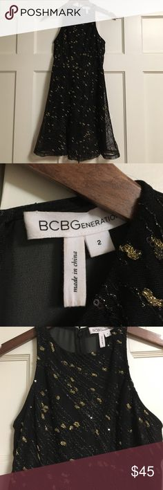BCBGeneration adorable party dress Fantastic black sequined and gold fleck net overlay. Upper back is sheer. Cute flounced hem. Size 2 but fits more like a 0. Perfect for the holidays! BCBGeneration Dresses Mini