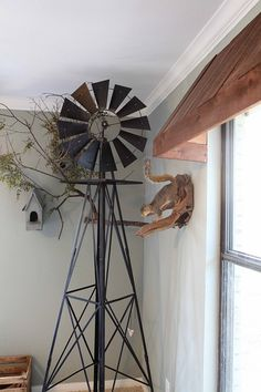 how awesome is this?!?  windmill  outdoor awning in a kid's room!  taxidermy too . . . !