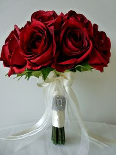 Robyn  - A stunning hand-tied posy of seventeen large, claret open roses.