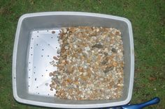 hmm...Pea gravel and two layers of litter boxes for a washable, reusable, waste-free cat litter alternative.