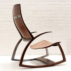Maker of boats, kitchens, lighting and more, woodworker Reed Hansuld creates sculptural furniture pieces with a monk-like reverence for their functionality and longevity. Though utility-focused, his pieces are also works of art. With a steel skeleton and graceful wooden curves, his modern Rocking Chair No. 1 breaks any stereotypes you had about the classic rocker.