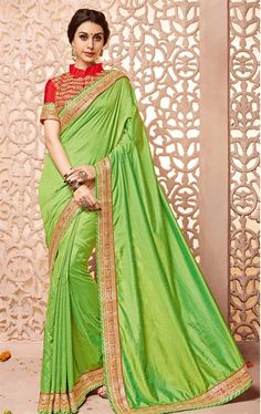 Picture of Dazzling Parrot Green Silk Saree with Designer Blouse