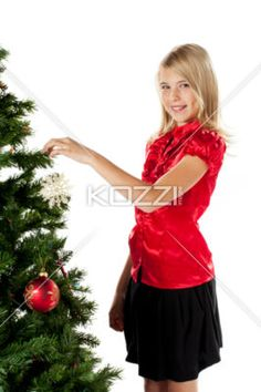 blonde girl decorating christmas tree. - Portrait of a blonde girl decorating christmas tree, Model: Shania Chapman - Agent is Breann at MMG. breann@nymmg.com