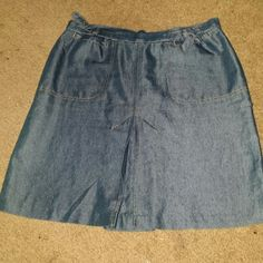 Old Navy skirt Jean look shiny material when it hits the light Size 8  Has two small pockets by the top along with belts to loosen and tighten  I'm 5'4 and comes right above knees  If you have questions please ask Skirts