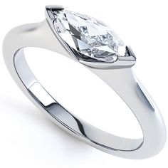 R1D072 - For the the lover of contemporary engagement ring styles, that echo simplicity, modern styling, and minimalism. R1D072 is a boat shaped 'Marquise' brilliant cut diamond, which is held in a sideways setting, above knife edged tapering shoulders, with a court ring profile.