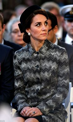 Kate wore her brunette locks swept back into a low chignon, which just peeked out from beneath her hat