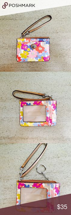 NWOT COACH Mini Skinny ID Wallet/Key pouch Floral NEW WITHOUT TAG COACH Mini Skinny ID Wallet/ key pouch in cute multi Floral pattern/color! NOTE: Last 3 pictures show product in different color but similar style. IN ADDITION to the style displayed in last 3 pics- this mini id has a WRISTLET LEATHER STRAP & ANOTHER FRONT CARD SLOT. Features: 2 card slots(front&back), transparent ID slot(back), middle lined zip compartment, attached key chain, leather wristlet strap, Multicolor coated canvas…