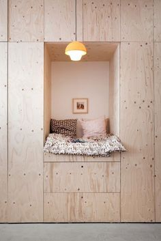 Bed Nook/Remodelista. Surrounded by wardrobes would be pretty anazing