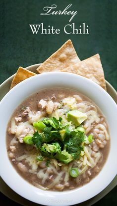 White chili made with cooked turkey, great for using up Thanksgiving leftovers, with white beans, green chiles, jalapeno, and garnishes. On SimplyRecipes.com