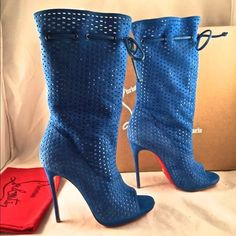 NIB Christian louboutin boots NIB Christian Louboutin Jennifer 120 Suede Blue Perforated Open Boots 36.5 $1995  ********** Christian Louboutin **********   Brand: Christian Louboutin Size: 36.5 (know your Louboutin size)  Name: Jennifer Color: Blue Style: Mid Calf Boots Style#: 1150779 Material: Suede Retail: $1,995+tax Mid calf length Open front toe Blue soft suede fabric Perforated material Scrunch top leather string tie Thin back heel Pull on style Made in Italy Classic red leather sole…